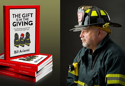 Bill Arienti in fireman uniform and book The Gift of Giving